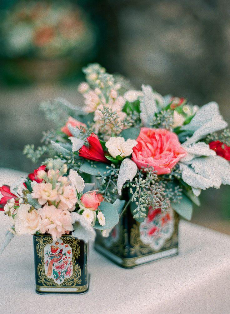 Tea tins used as rustic vases