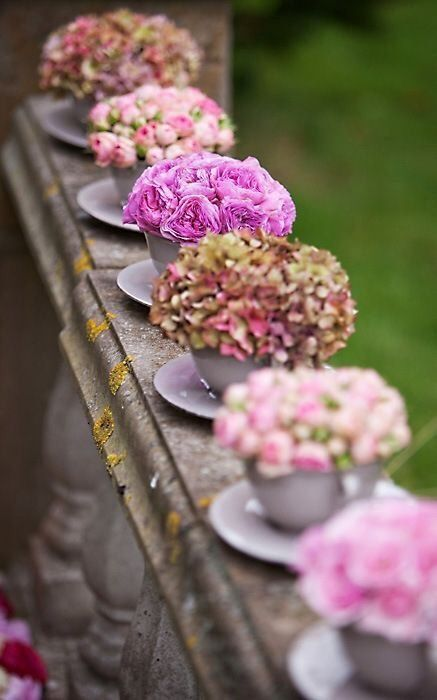 Teacups used as unusual flower vases